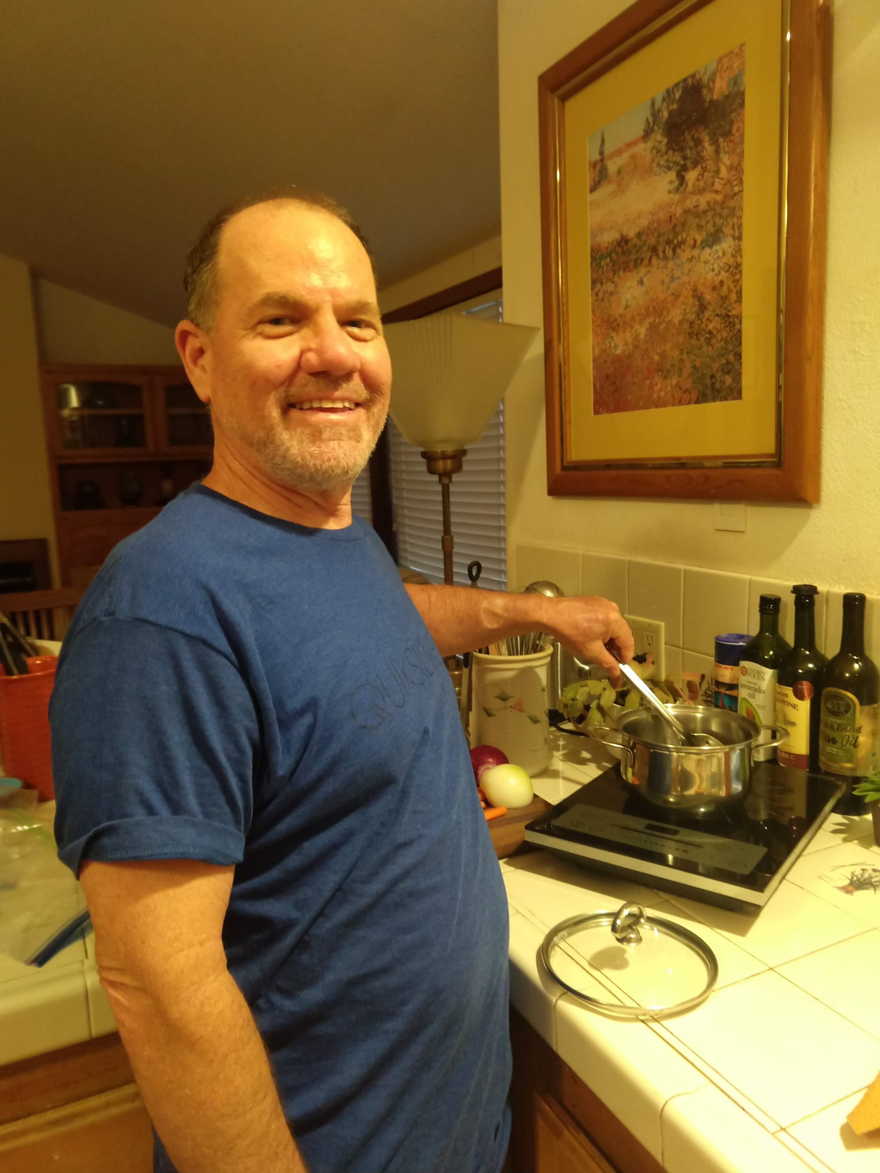 Man in front of Induction Stove